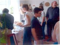 people gathering at a potluck supper